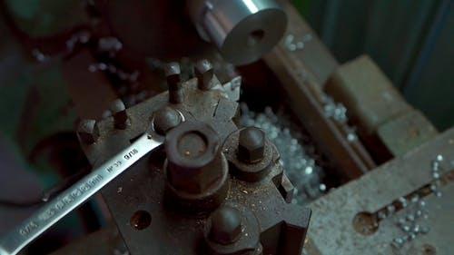 Close Up View of Metal Shaping through Machine
