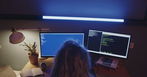 High Angle Shot of a Female Coder Working at Night