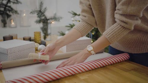A Person Wrapping Christmas Gifts