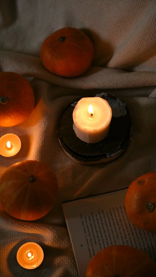 Top View of Candles and Pumpkins