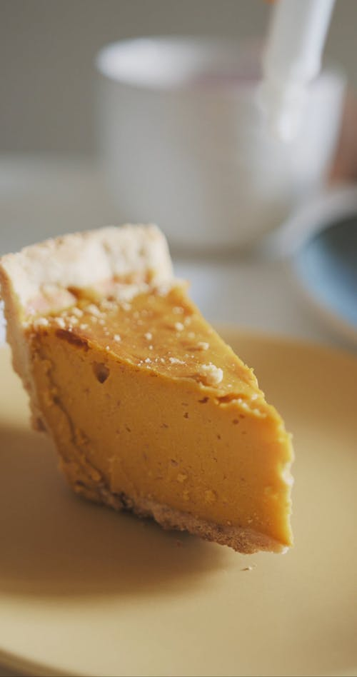 Close-Up View of Pumpkin Pie With Whipped Cream