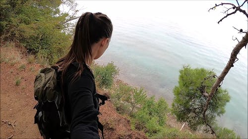 A Girls Standing By The Edge Of The Cliff