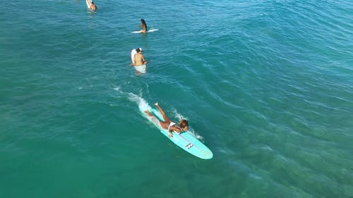Drone Footage of a Woman Surfing