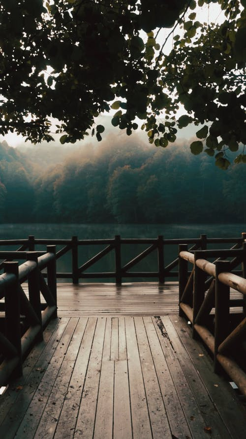 Man on a Pier at a Beautiful River