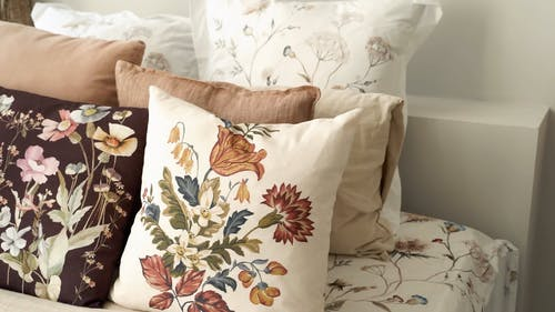Pillows with Floral Designs on the Bed