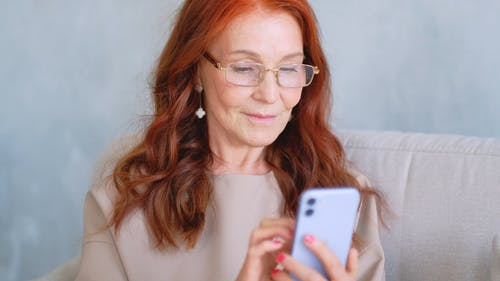 A Woman Using An Iphone