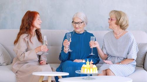 Three Woman Drinking White Wine
