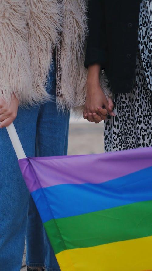 Holding A Rainbow Flag