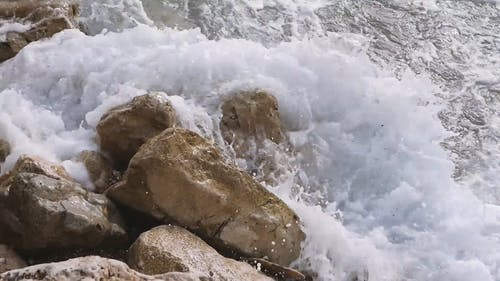Crashing Waves in the Rocky Shoreline