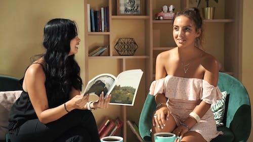 Women Having Coffee Inside A Cafe