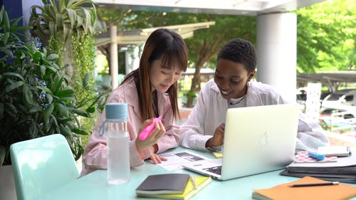 Two Women Doing Some School Works