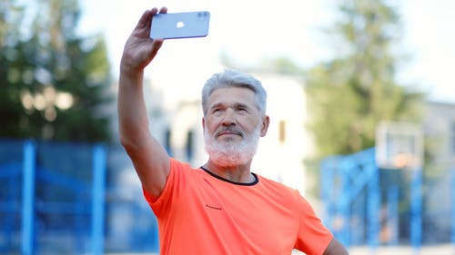 Shallow Focus of a Man Taking a Selfie Using His Smartphone