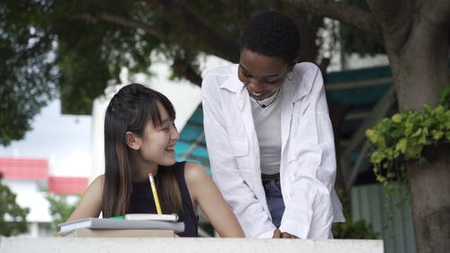 A Woman Tutoring Her Fellow Student