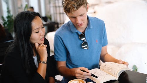A Young Couple Doing self Study in a Cafeteria