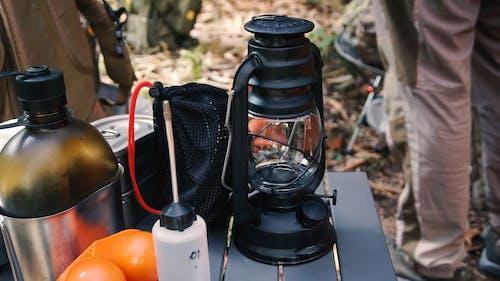 A Person Lighting a Gas Lantern