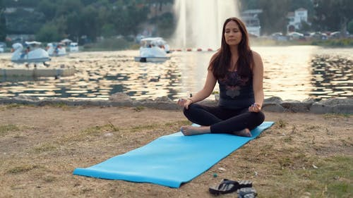 Woman Meditating at a Park