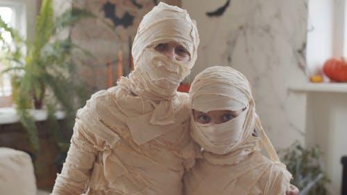 Kids Wearing Mummy Costumes For Halloween