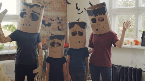 A Family Wearing Paper Bag Masks