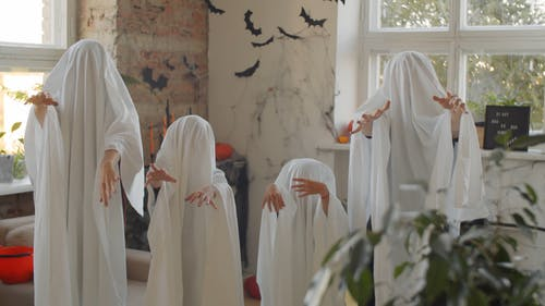 A Family Wearing Ghost Costumes