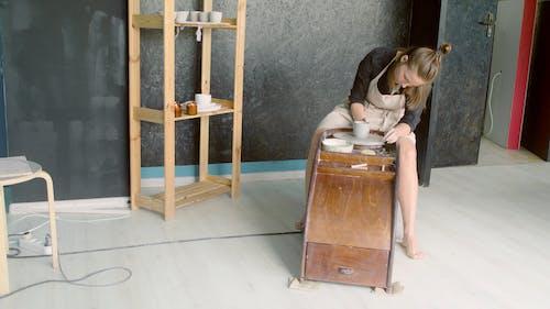 Woman Doing a Pottery