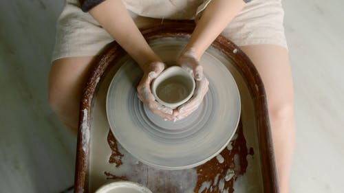 Person Molding a Pot
