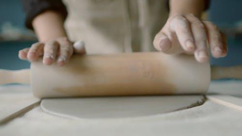 Person Molding a Clay