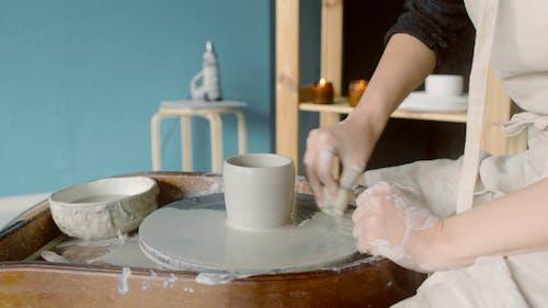 Person Making a Pot