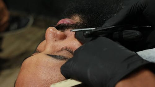 Person Shaving a Beard