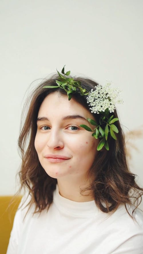 Beautiful Woman Smiling with Flower in her Hair