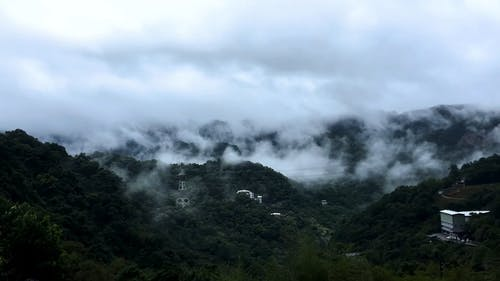 Landscape Scenery of Mountain Under Cloudy Sky