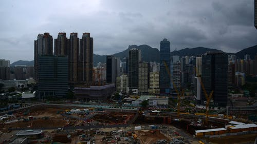Time-Lapse View of City Buildings Under Cloudy Sky