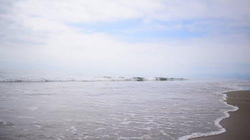 Sea Waves Crashing In The Beach Shore
