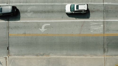 Top View of Cars Driving on Roadway