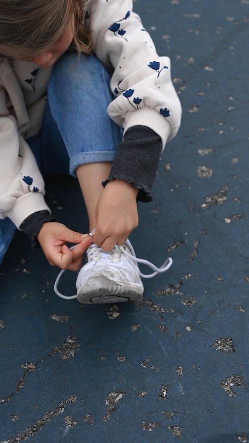 Girl Tying Her Shoe