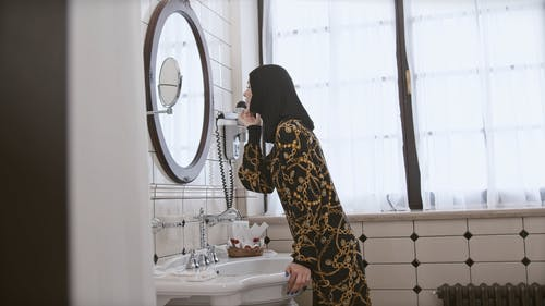 Young Muslim Woman Applying Makeup