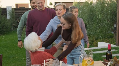 Family Members Greeting Their Grandmother