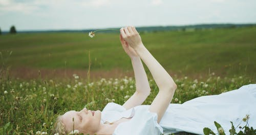A Woman Lying Down on the Meadow