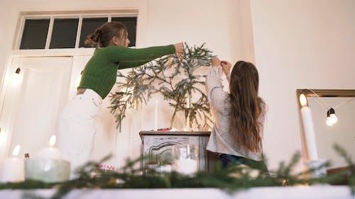 Girls Decorating Their Christmas Tree