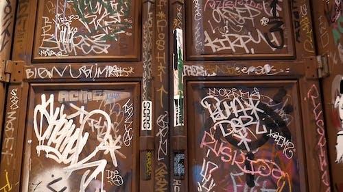 A Vandalized Wooden Door