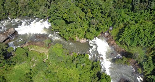 Drone Footage Of A Rapid River With Waterfalls