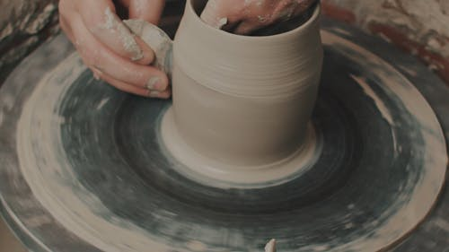 Close-Up View of a Person Doing Pottery