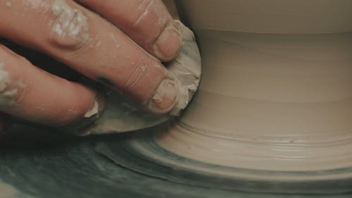 Close-Up View of Person's Hand While Doing Pottery