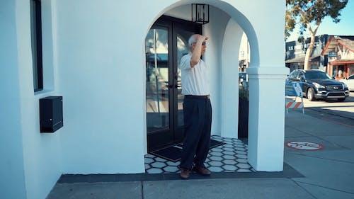 Elderly Man Standing Outside The Restaurant Waiting For Someone