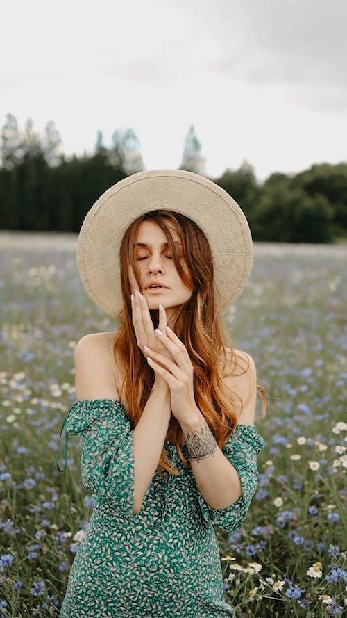 A Woman Pictorial In A Flower Field