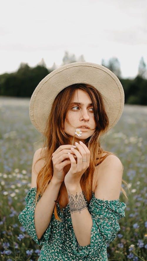 A Woman Standing In Th Flower Field