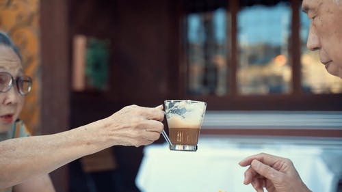 Elderly Couple Sharing A Cup of Coffee