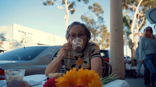 Elderly Woman Drinking Coffee Outdoor