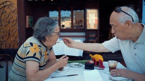 Elderly Couple Having a Coffee Date