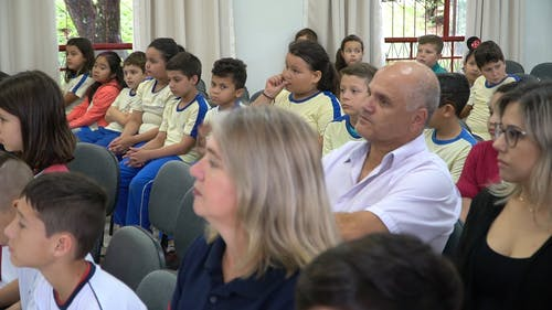 Parents And Students Attending A School Meeting