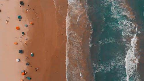 Top View of Ocean Waves Crashing on Beach Shore
